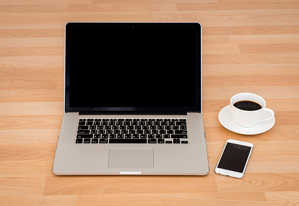 Laptop, phone and keyboard - flexible working