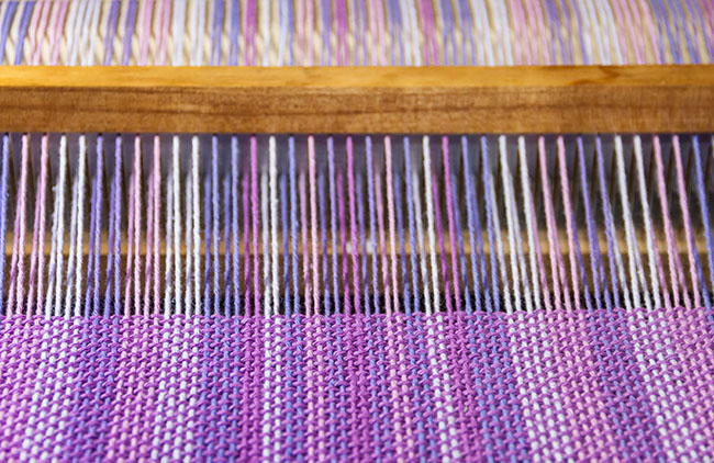Close-up of thread on loom. AI