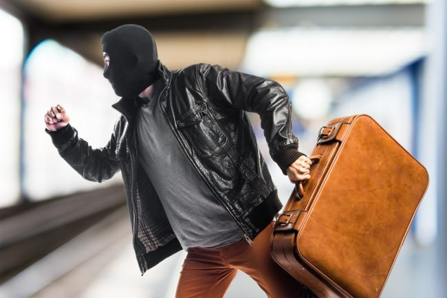 Masked robber running away with suitcase - Google Titan