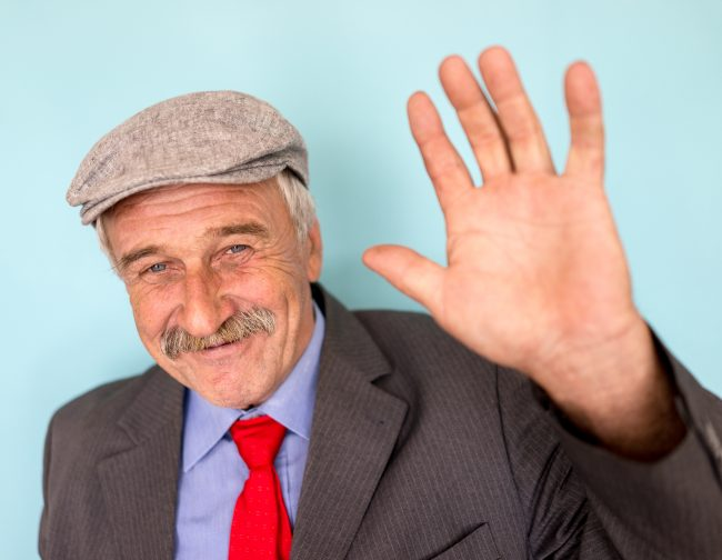 Man waving to camera