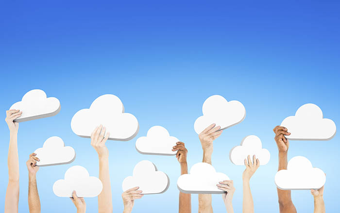 Lots of hands holding up cloud shapes - do small businesses need servers?
